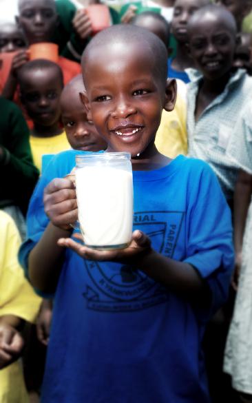 tanzanianboywithlargejugofmilk_byeadd_croppedsusanmacmillantanzanianboywithlargejugofmilk_byeadd_cropped